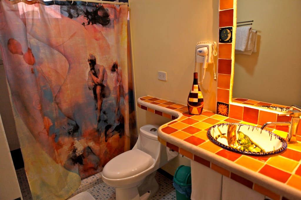 Bathroom is decorated with mexican talavera