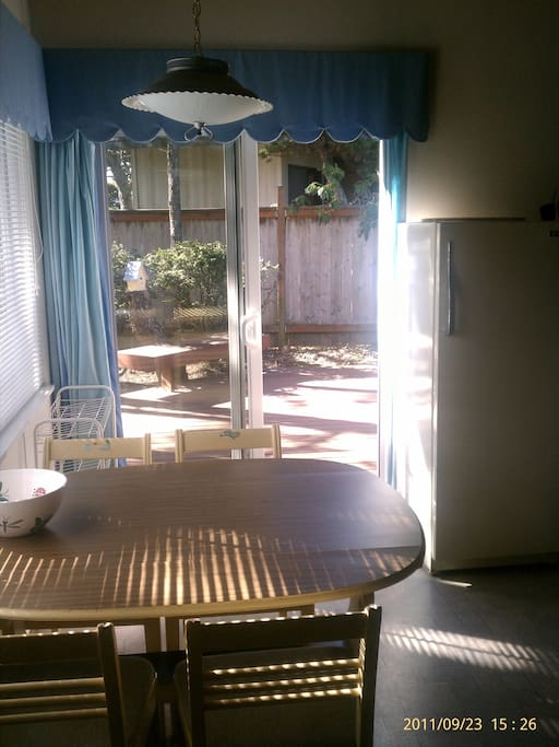 Kitchen seating area with view of the outside deck