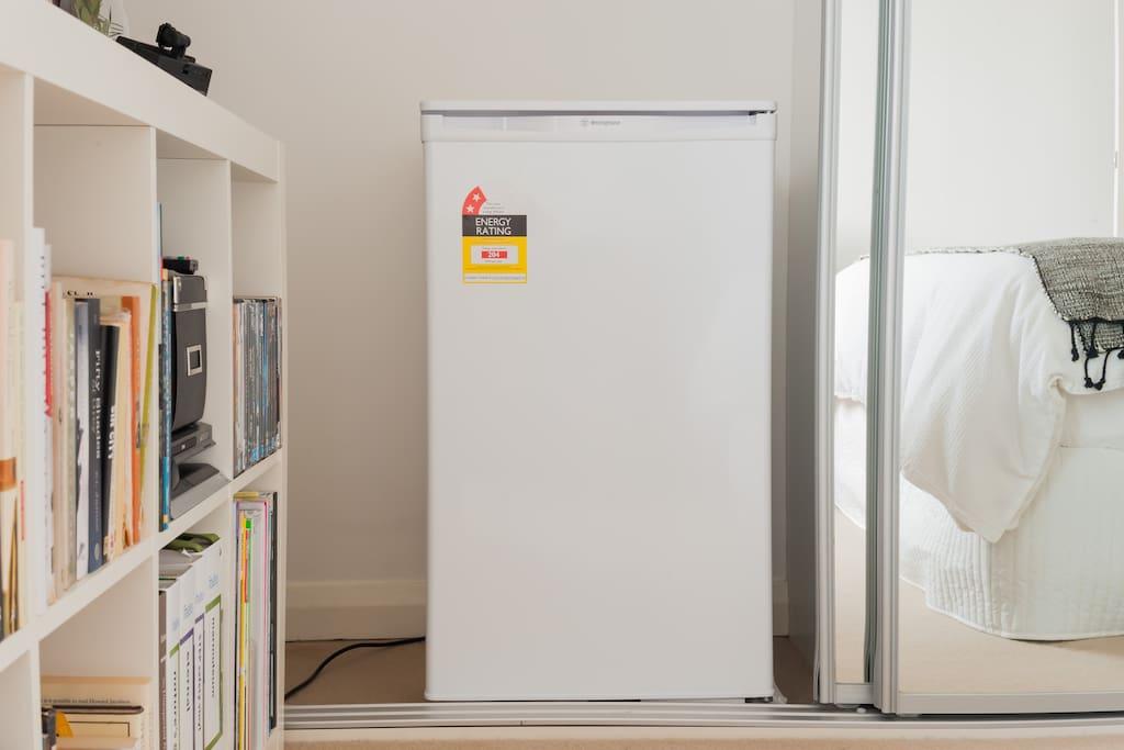Mini bar fridge in room