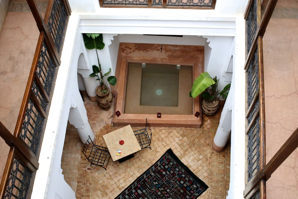 Large courtyard dining area with plunge pool