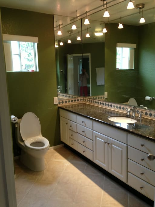 remodeled bathroom with new granite countertops