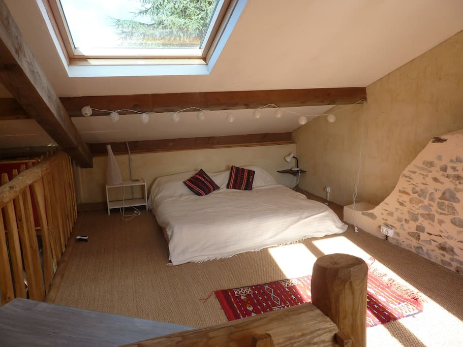 Your king- sized Bohemian style bed upstairs in La Petite Maison can also convert into two twin beds.