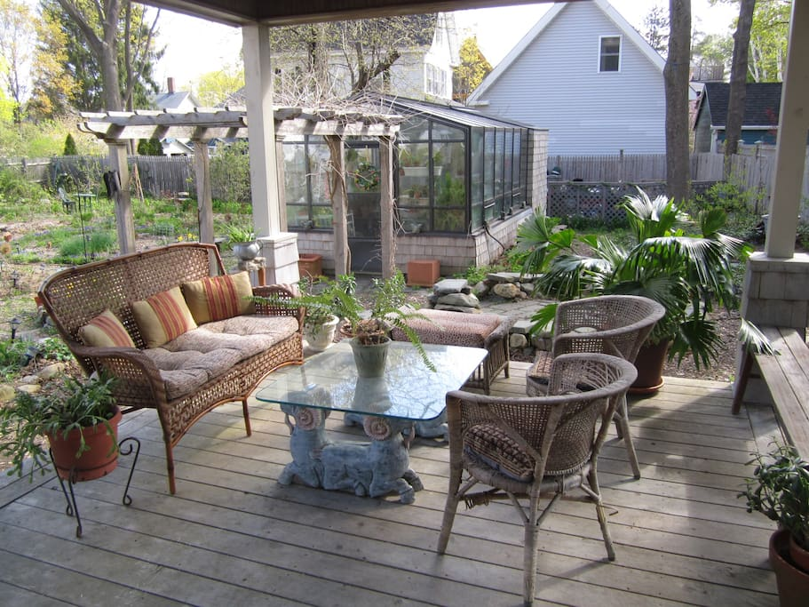 Porch and gardens, with greenhouse and pergola
