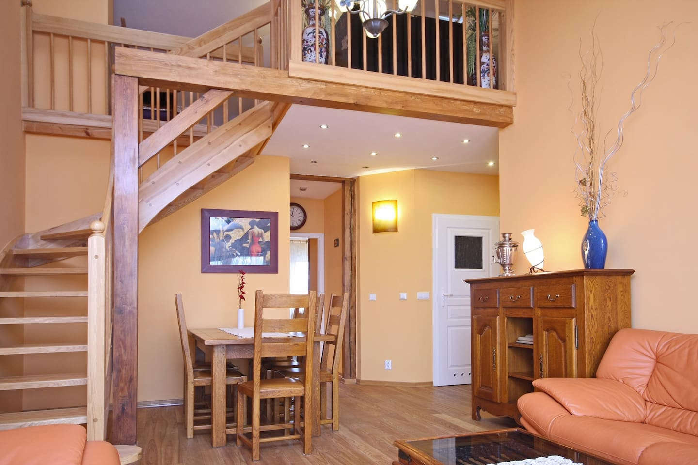 Spacious Living / Dining room with beautiful oak furniture, large extendable table for up to 8. Stairs leading to main bedroom on mezzanine floor.