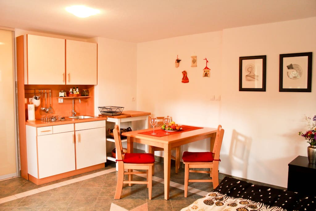 Kitchen with stove, fridge, microwave and all kitchen utensils.