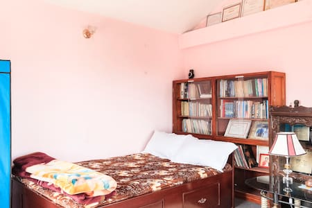Private room in a well-maintained, extremely clean, resort-style house in a hill with a great view of Swoyambhu Nath Temple. Peacefully away yet only 15 minutes ride from the center of Kathmandu city. Western style restroom with hot-water. Free WiFi.