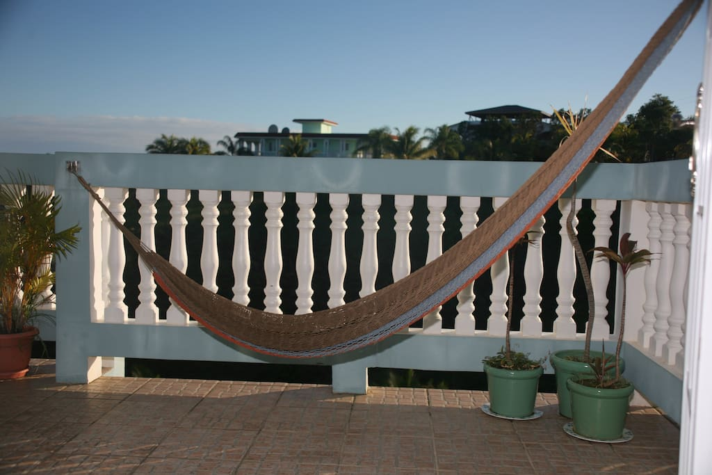 Grab a book and lay back in the hammock taking in the sun and sea breeze