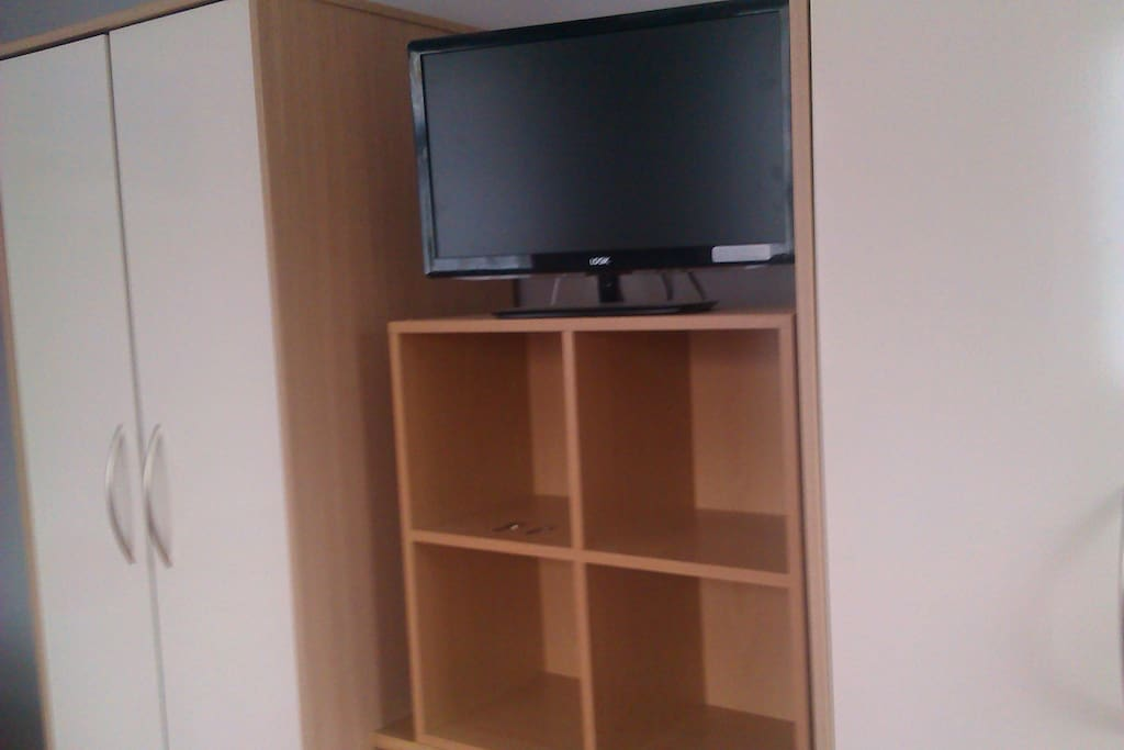 Television and Dvd Player built in with two wardrobes and chest of drawers underneath shelving