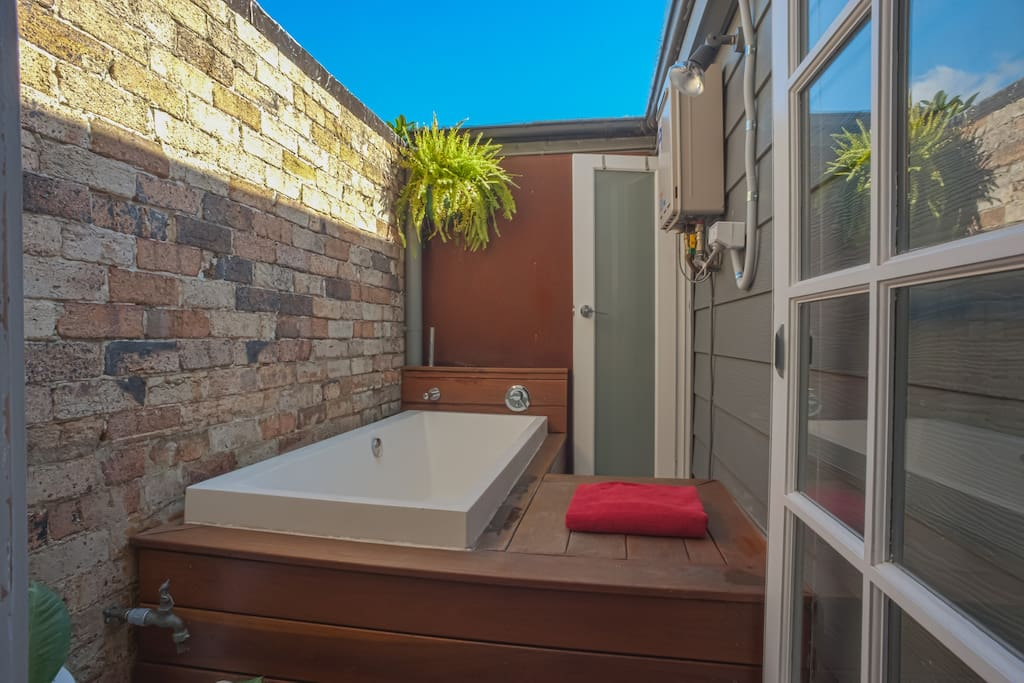 Our favourite part of the house - the outdoor bathroom. Nothing like relaxing here after a long day. Note the board to set down your red wine glasses. The sky is not photoshopped.