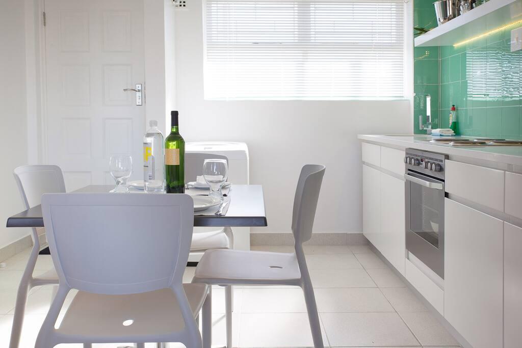 The kitchen, note the washing machine in the corner under the window.