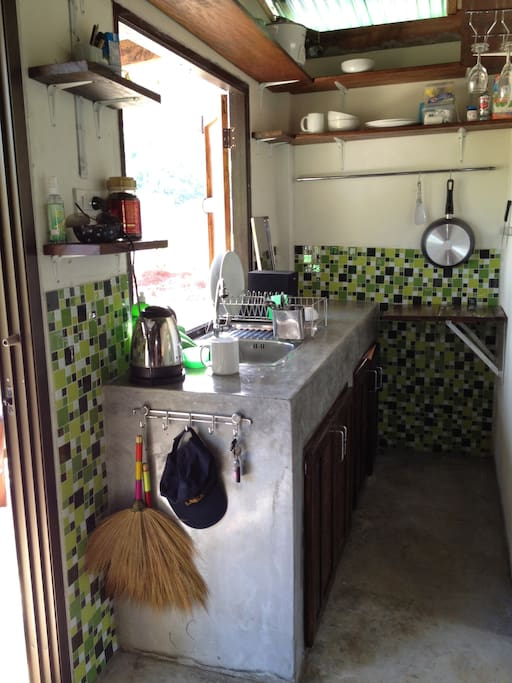Polished cement kitchen area that opens onto garden dining area. Refrigerator & gas cooking.
