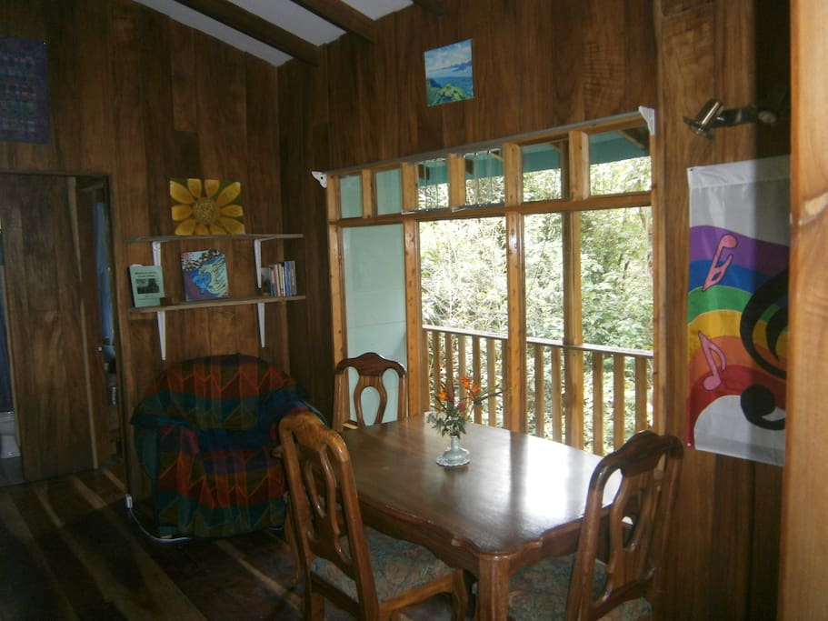 :Living/Dining room looks out on the forest too!