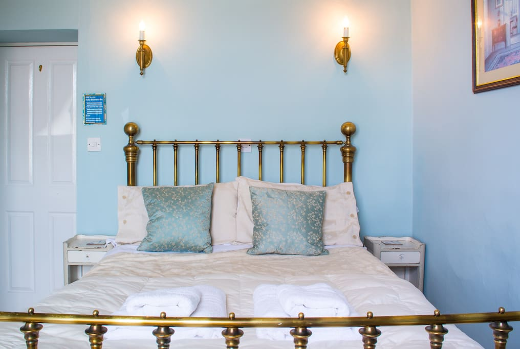 The Blue Room is decorated in Laura Ashley colours and soft furnishings. There are some painted French antique pieces in this pretty room for that shabby chic look.