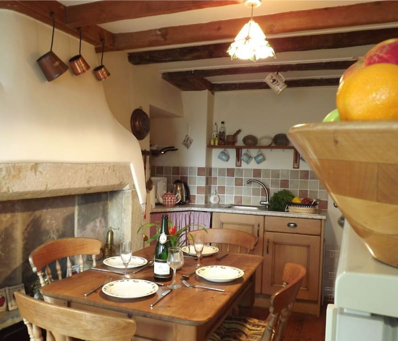 Kitchen with dining table and original bread oven