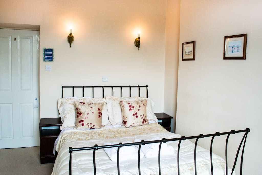 Claife Heights has a Laura Ashley wrought iron sleigh bed with a very comfortable bespoke pocket sprung mattress for a good night's sleep. We use quality Dormer bedding for all our rooms.