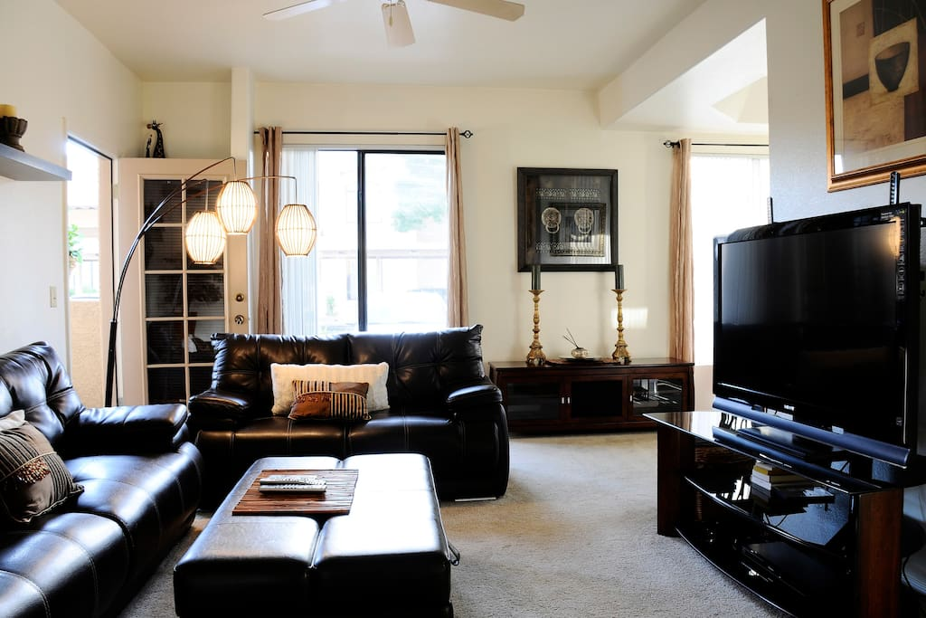 Living room with huge flat screen tv- perfect for watching movies in HD