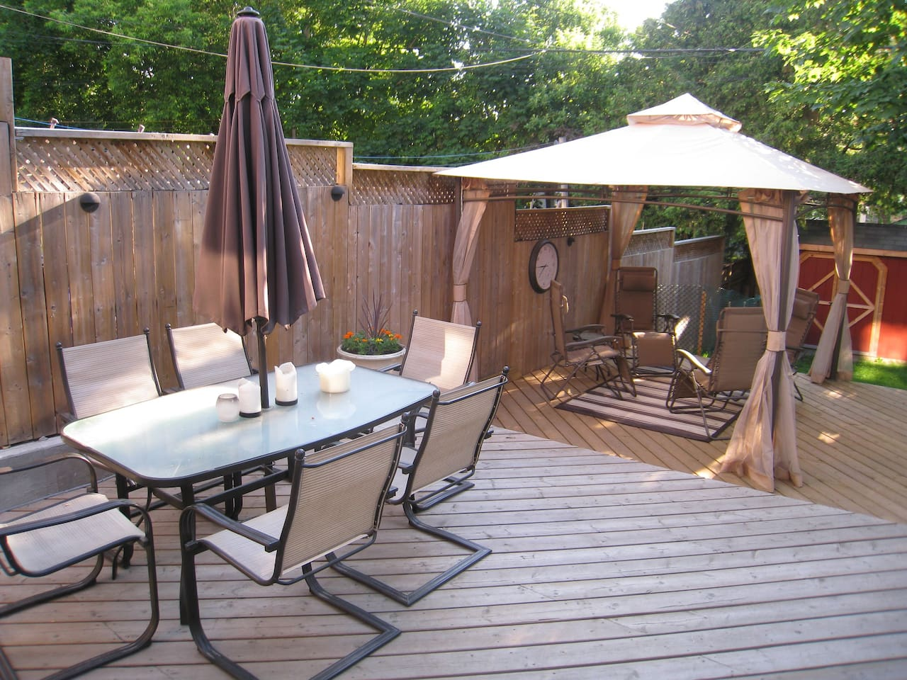 Back deck with separate sitting areas, BBQ and canopy