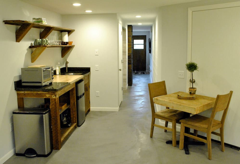 Custom kitchenette built from reclaimed barn wood comes with fridge, convection oven, induction cooktop and coffee pot.