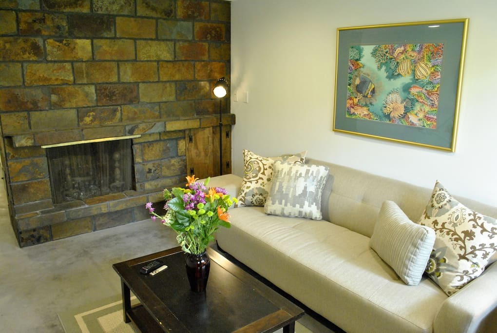 The living room has a fully functioning fireplace and great natural light for reading.