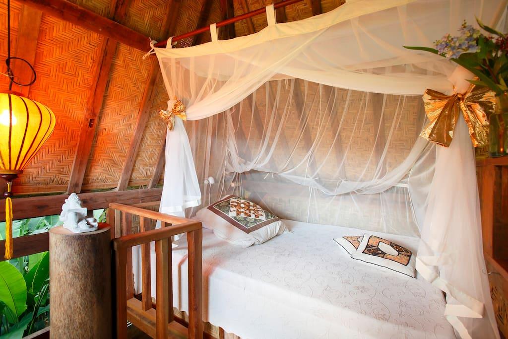 Wifi, reading light, breezy mosquito netting, comfortable mattress.