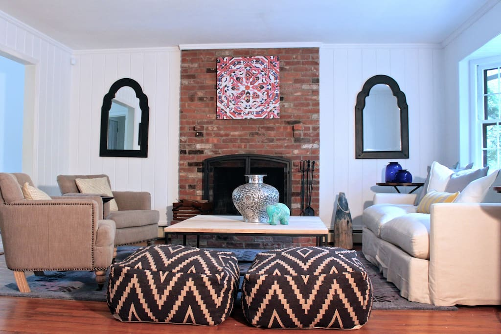 Large living room with an antique brick fireplace and plenty of seating.