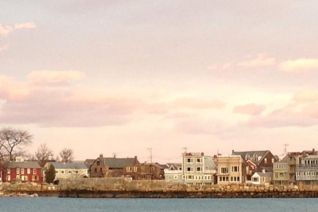 View from Front Beach of stores on Bearskin Neck