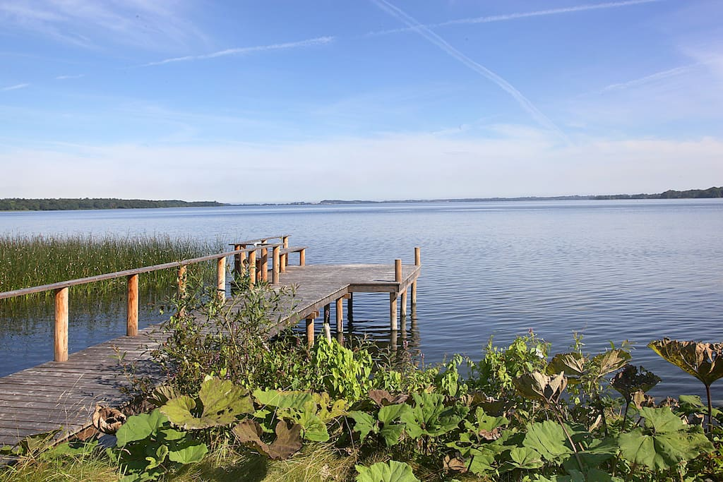 View of lake and private wooden pier