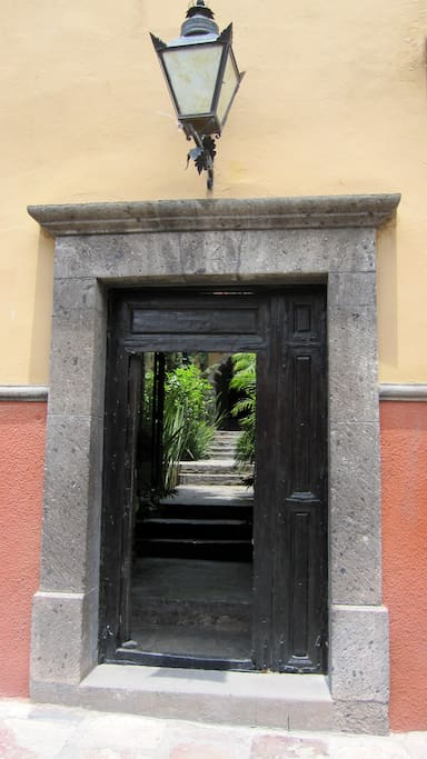 View through the front door, through the entry and to the patio beyond.