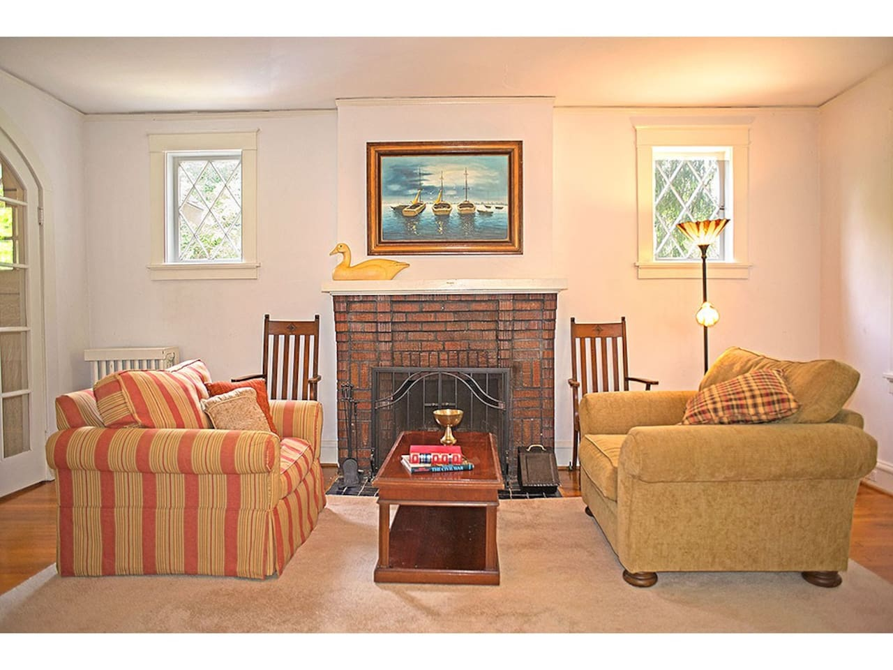 A cozy area for conversation or relaxation near the living room fireplace.