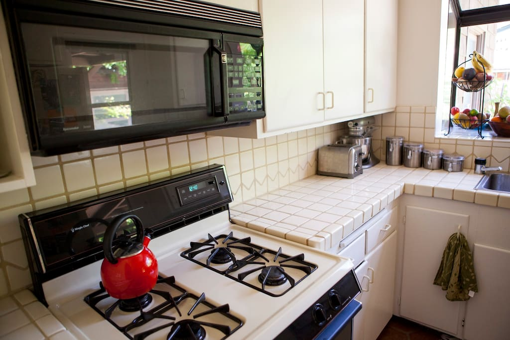 Full Kitchen: microwave, gas stove,  and full range of kitchen appliances.