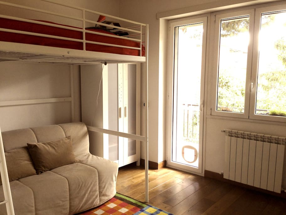 Bright room with private balcony