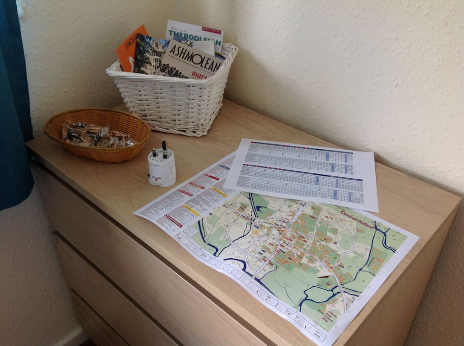 Touristic map of Oxford, bus timetable, universal power adaptor