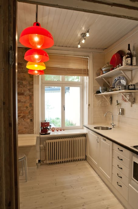 A little cozy kitchen  with all you need (espresso machine, dish washer, a stove) and a table for 2 people.