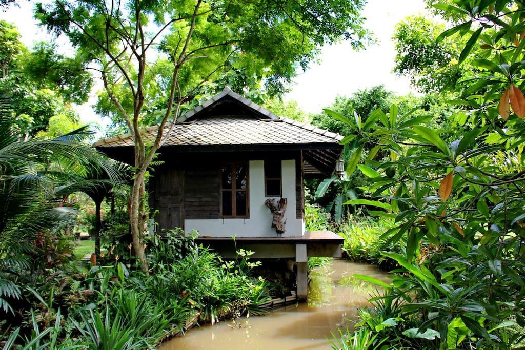 Frangipani villa, set over the stream that runs through the garden
