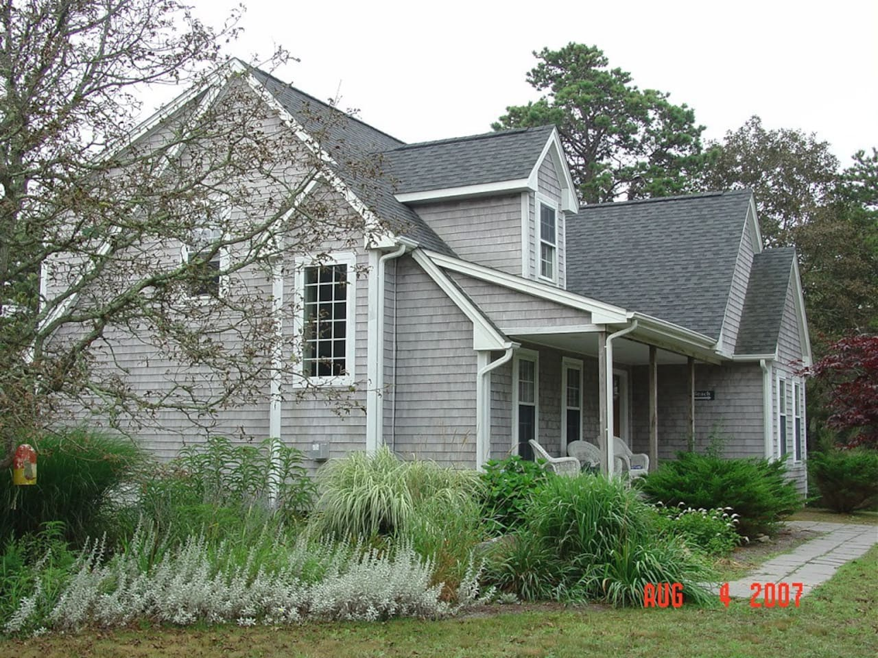 Beautiful gardens surround the house.  Enjoy your morning coffee on this great porch