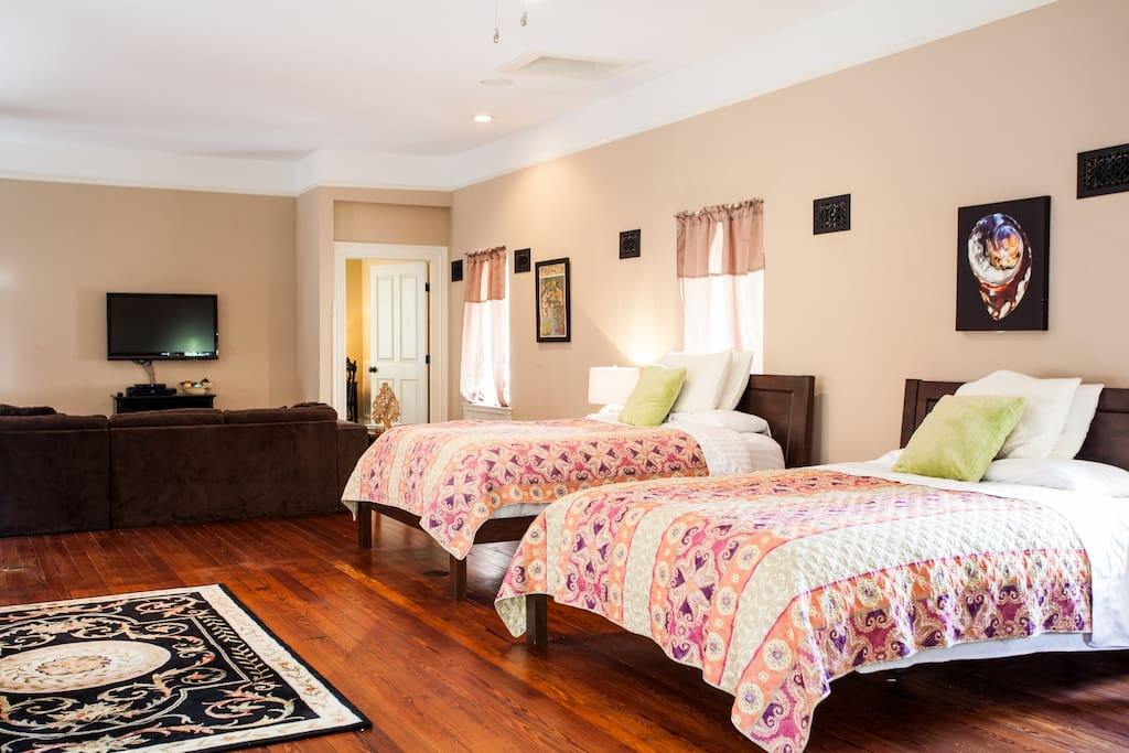 This room has 2 comfortable queen beds and a daybed with nice linens.
