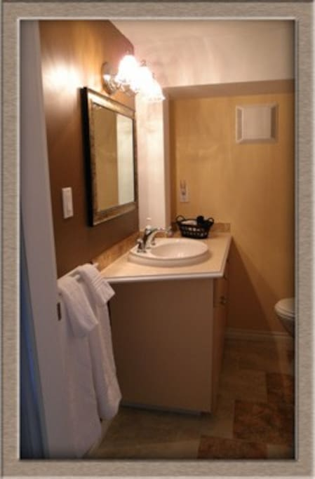 Very clean bathroom with neoangle shower.