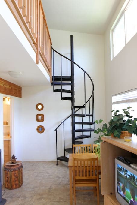 Spiral staircase leads up to upstairs sleeping area.