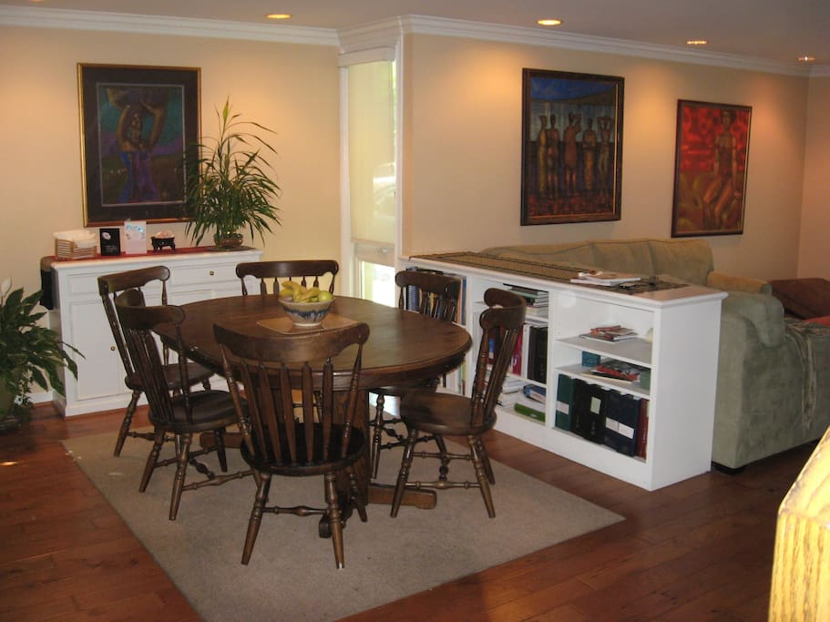 View of dining area, dining sideboard and partial view of living room.