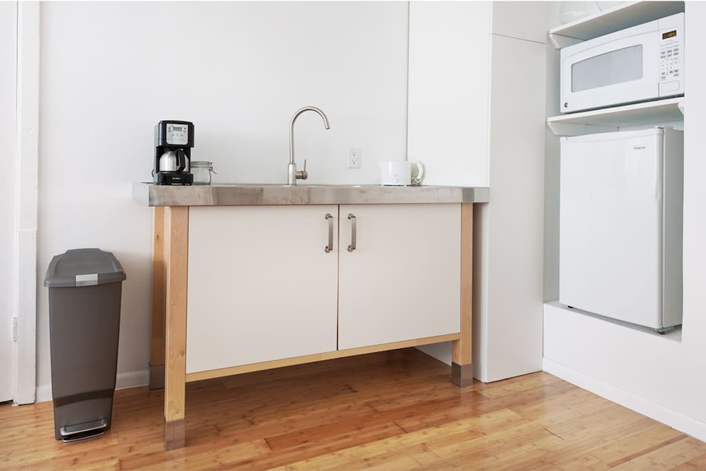 Kitchenette with fridge-freezer/microwave/coffee maker.