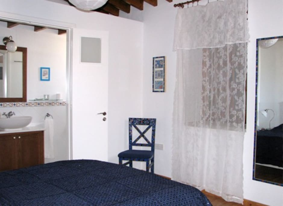Upstairs Bedroom & WC/shower. There is a ceiling fan and clock radio,