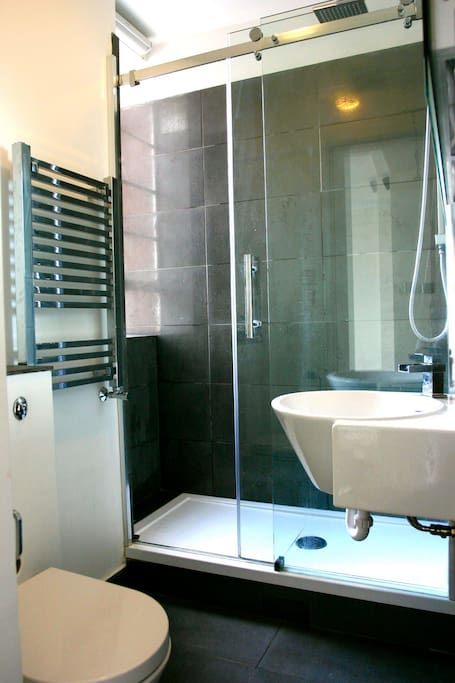 Bathroom includes large wetroom-styled shower and heated mirror for steam-free gents' shaving