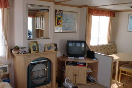 Our Mobile Home is in a family run Park within walking distance of the stunning Banna strand, which is a blue flag beach. It has miles of beautiful beach sheltered by dunes. Situated just 10 minutes from the bustling busy shopping town of Tralee.