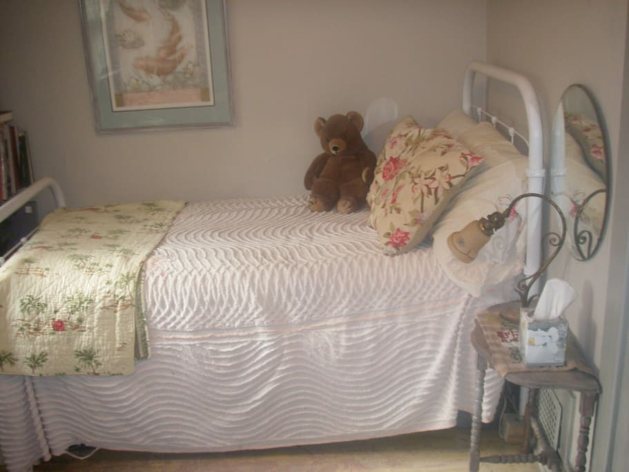 A snuggly bed in a cute little room.