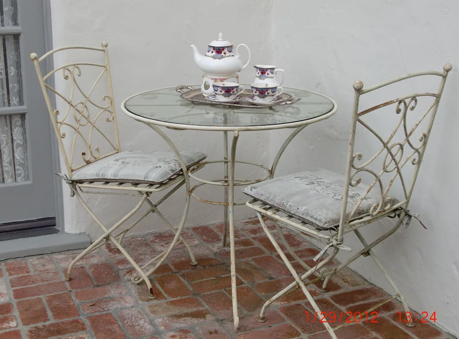 Front porch great for afternoon tea...