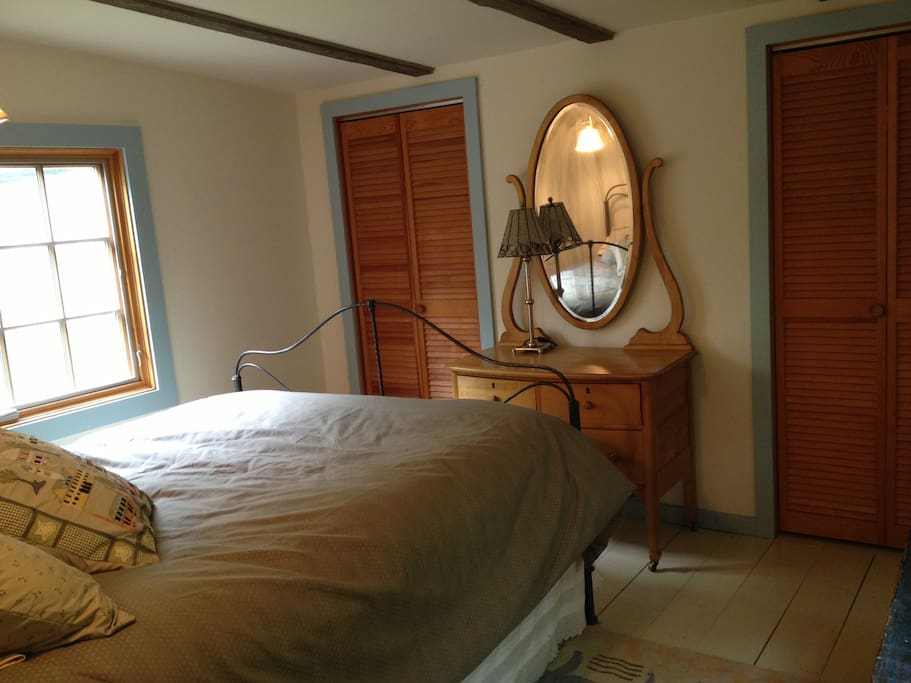 The guest room has a very comfy bed, big closet and views of the mountain.