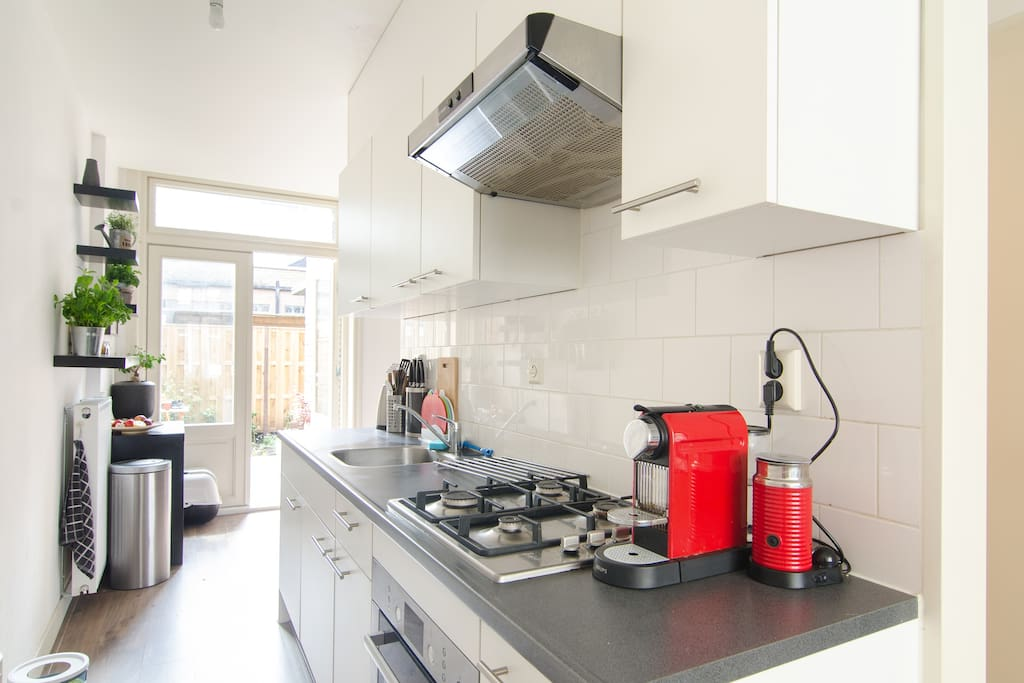 kitchen with oven, fridge and coffee machine