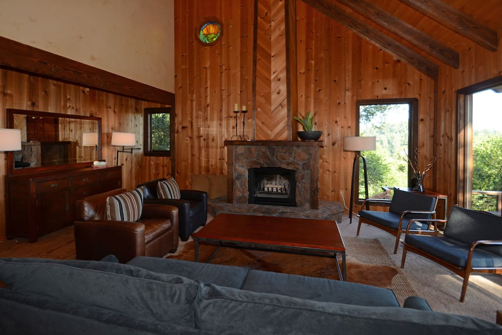 Living room has a wood burning fireplace and beautiful views of the garden, valley and vineyards