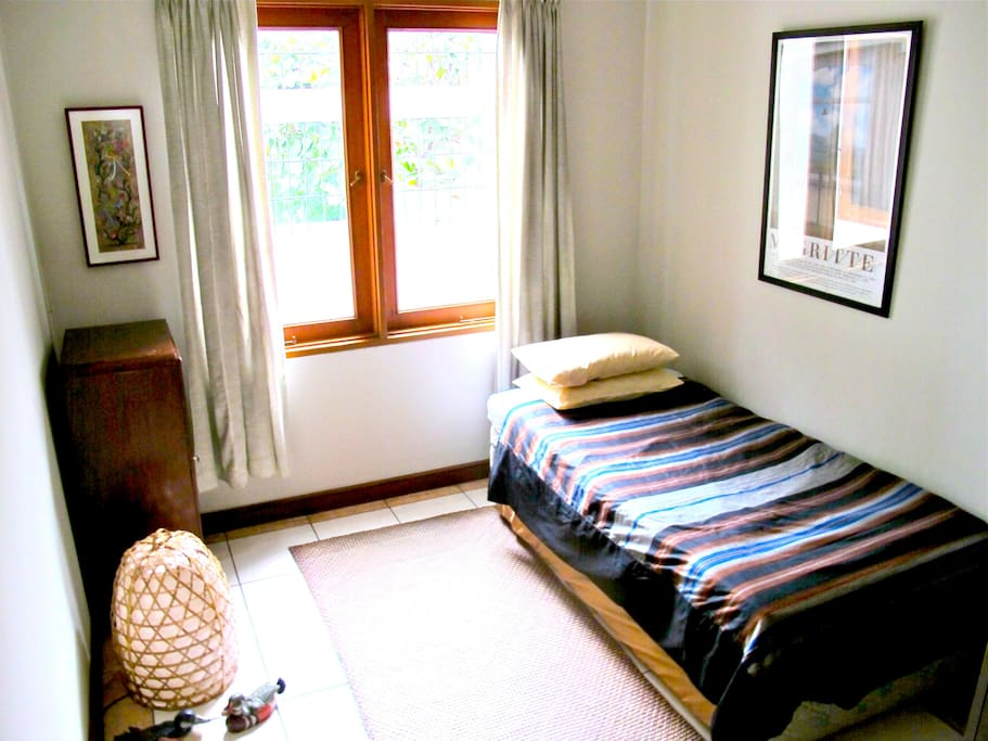 The thoughtfully put-together guest bedroom. Comes with a spare mattress.