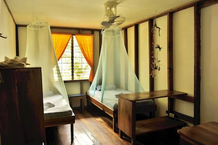 Room w/ 2 singles & shared bathroom